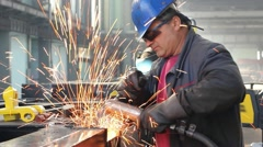 Workers grinding and welding in a factory Stock Footage