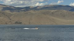 Two Girls on a Jet Ski on Topaz Lake - zoom out Stock Footage