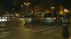 Night time directing traffic, Rome Stock Footage