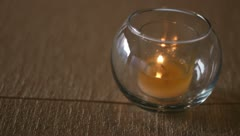 Candle on tan tablecloth Stock Footage