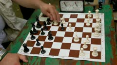 People play chess with time limit, closeup view of table Stock Footage