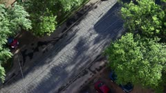 Tramways ride in opposite direction among trees, view from above Stock Footage