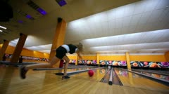 Girl throws bowling ball and makes strike by beats all skittles - stock footage