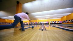 Man throws bowling ball and makes strike by beats all skittles Stock Footage