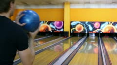 Boy throws bowling ball and then dances happy with result - stock footage
