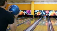 Boy throws bowling ball and then dances happy with result Stock Footage