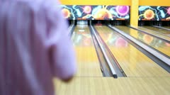 Man throws bowling ball and makes strike by beats all skittles - stock footage