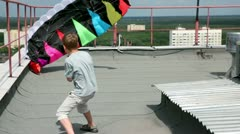 boy stand and hold shroud lines, parachute inflated by air - stock footage