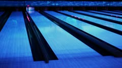Ball thrundles in flume near bowling lane at dark club Stock Footage