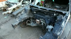 Several scrapped vehicles on junk yard, shown in motion - stock footage