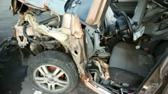 Few scrapped vehicles after car accident stand on junk yard - stock footage