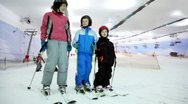Mother with her kids stand on ski and talk Stock Footage