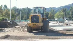 Front Loader working in construction site Stock Footage