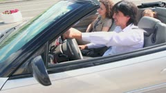Buckle up family in cabriolet pass by at sunny summer day Stock Footage