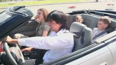 Buckle up family ride in cabriolet at sunny summer day Stock Footage