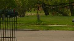 Homeless man and cart walking through frame Stock Footage