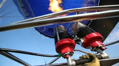 Burning torch heats up air in balloon of club of aeronautics Stock Footage