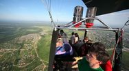 People fly in basket of balloon, examine landscape from height Stock Footage