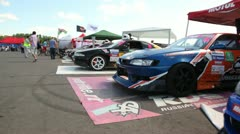 Cars stand ready by  beginning of competitions Stock Footage