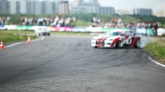 Cars go about tribunes with audience on drift Megafon-RDS 2011 Stock Footage