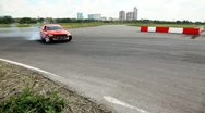 Stock Video Footage of Cars rush on racing route against city landscape