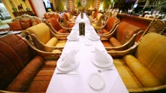 Decorated tables stand in center of lounge of east restaurant Stock Footage