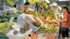 Buying Fruit at a Fresh Fruit Market in Thailand Stock Footage