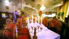 Lounge of restaurant is located behind candlestick with candles Stock Footage