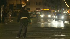 Night traffic in Rome with cop (1) Stock Footage