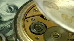 dollar and the old pendulum clock. loopable. - stock footage