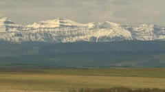 Snow covered Rocky Mountains in early spring Stock Footage