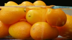 Kumquat in a transparent bowl close up. - stock footage