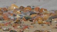 Pebbles and waves Stock Footage