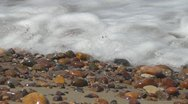 Pebbles and sea waves Stock Footage