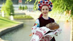 Girl with a loaf. Welcome to Ukraine. Ukraine. Donetsk. Euro-2012. - stock footage