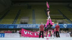 Gymnasts of teams participates in Championship on cheerleading Stock Footage