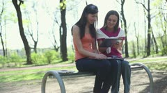 Young college students using a tablet computer, tracking shot HD - stock footage