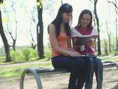 Young college students using a tablet computer, tracking shot NTSC Stock Footage