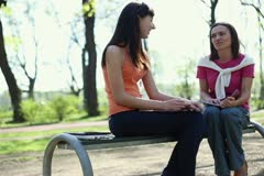 Two young college students talking in school campus, tracking shot NTSC Stock Footage
