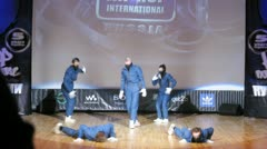Jumanji crew dances hip-hop on scene of palace of culture - stock footage