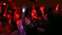 Young crowd partying and dancing to the music Stock Footage