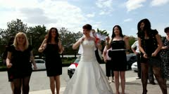 Bride and bridesmaids dancing on  her wedding day - stock footage