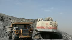 Loading the gold ore into heavy dump truck at the opencast mining Stock Footage