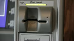 Stock Footage - ATM - Flashing lights, Screen, man inserts and removes his card Stock Footage