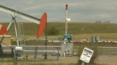 Oil industry, pump-jack, drill rig and sign nice frame Stock Footage