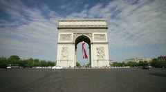 French flag under Arc de Triomphe, Paris Stock Footage