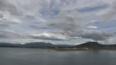 Argentina Ushuaia viewed in distance across channel pan Stock Footage