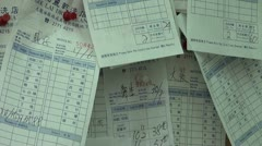 Bills of a dry cleaning service in Hong Kong Stock Footage
