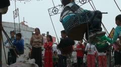 Uyghur kids are having fun in an old ferris wheel Stock Footage