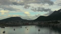 Argentina Ushuaia hills curve above small boat harbor Stock Footage